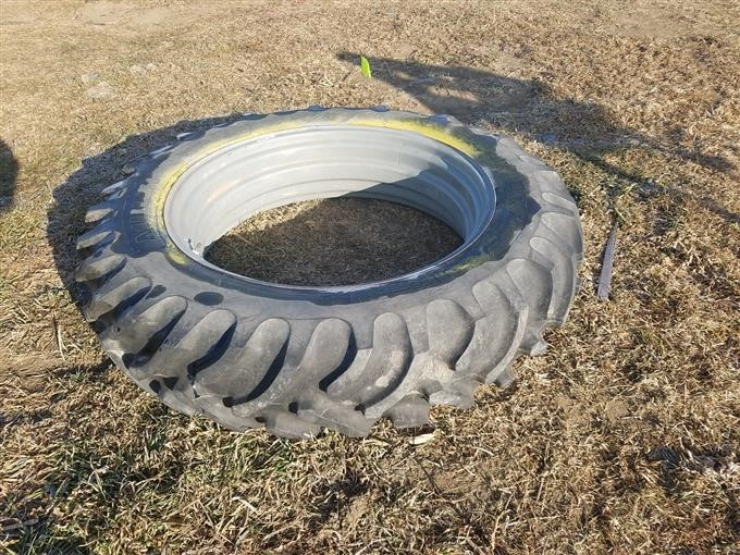 multi trac   rear tractor   tire mounting  rim bigiron auctions