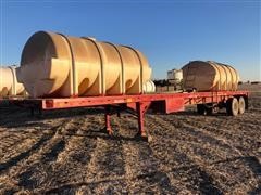 1982 Great Dane 45' T/A Flatbed Trailer w/ Two Tanks
