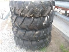 Titan 11.2-24 Pivot Tires On Steel Rims