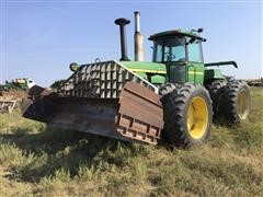 John Deere 8430 4WD Tractor W/Degelman Blade