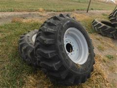 Titan 15-19.5 Tires On Gray Rims