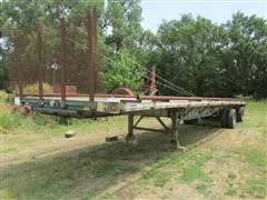 1999 Wabash National FLCHST T/A Flatbed Trailer