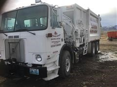 2001 Volvo 11 T/A Garbage Truck
