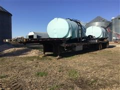 1990 Transcraft 48' T/A Spread Axle Step Deck Liquid Tender Trailer