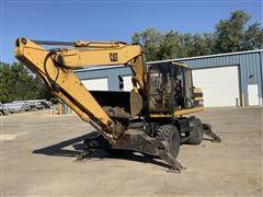 1995 Caterpillar M318 Wheeled Excavator