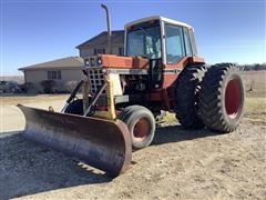 International 1586 2WD Tractor/Degelman Blade